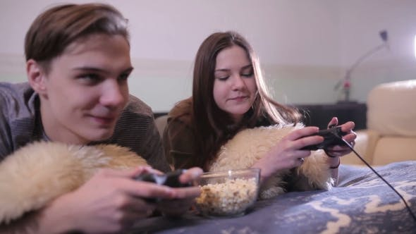 Thumbnail for Pair Of Students Playing Video Game At Home.