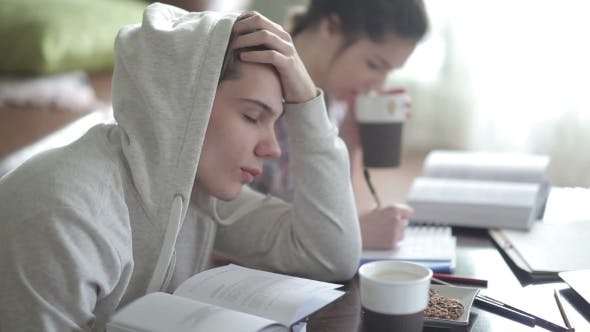 Thumbnail for Tired Male Student In Hoodies Falls Asleep.