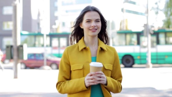 Thumbnail for Happy Young Woman With Coffee Cup On City Street 22