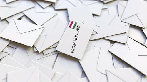 Envelope with From Hungary Text on Pile of Other Envelopes