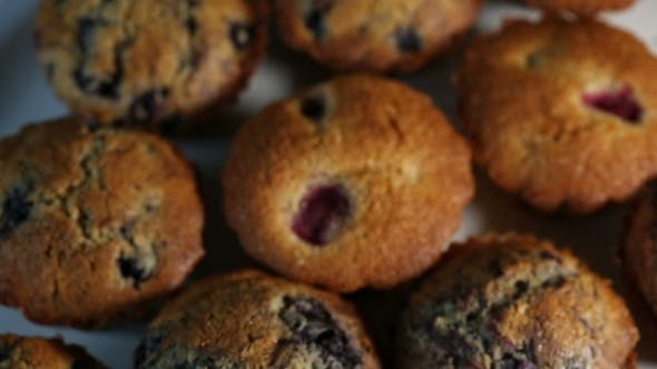 Thumbnail for Homemade Wholegrain Muffins With Berries On a White Plate