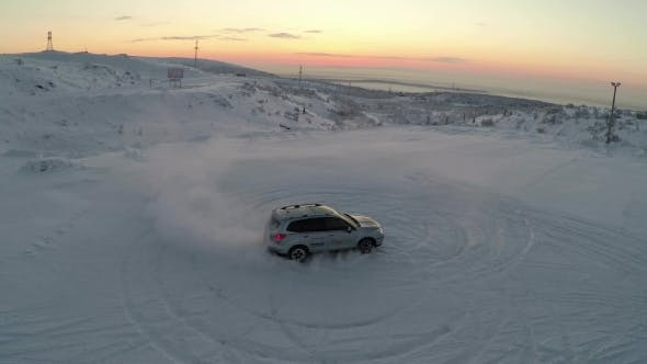 Thumbnail for Flying Over The Car Drifting On Snow