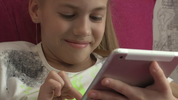 Thumbnail for Young Girl Using Tablet At Home 16