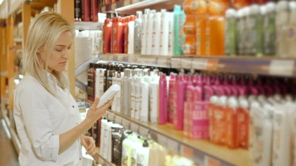 Thumbnail for Beautiful Woman Choosing Body Care Products In Supermarket