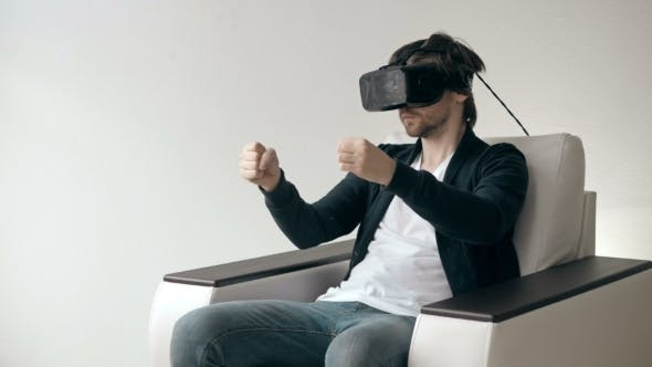 Thumbnail for Man Wearing Virtual Reality Glasses Watching Movies Or Playing Video Games