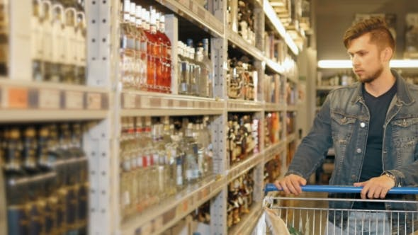 Thumbnail for Young Man Chooses Bottle Of Vodka In The Supermarket