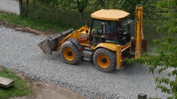 Thumbnail for Excavator Carries Gravel In The Bucket
