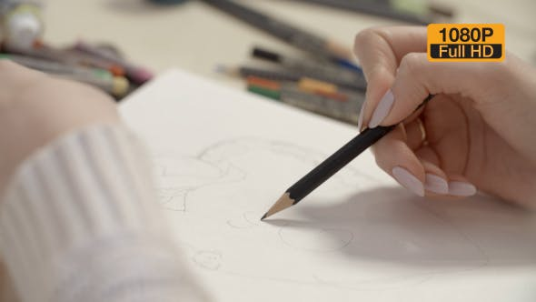 Thumbnail for Girl Drawing a Sketch With Pencil 7