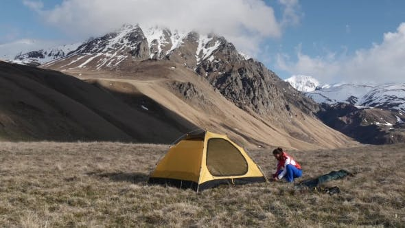 Thumbnail for Woman Setup a Tent In The Mountains