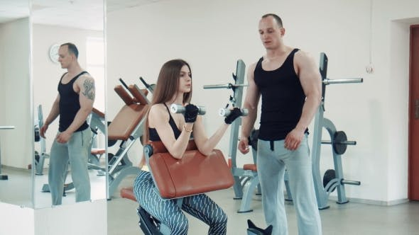 Thumbnail for Woman Doing Biceps Exercise With Dumbbells