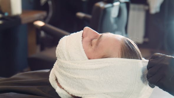 Thumbnail for Barber Wrapping Man's Beard In Hot Towel