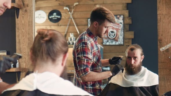 Thumbnail for Barber Trimming Man Looking At Mirror