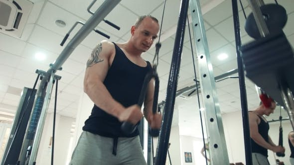 Thumbnail for Sportsman Doing Exercise On Triceps With Rope