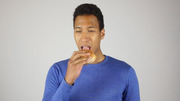 Thumbnail for Hungry Man Eating Burger, Taking Bite of Burger