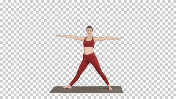 Thumbnail for Woman Practicing Yoga Standing in Extended Side Angle Exercise,