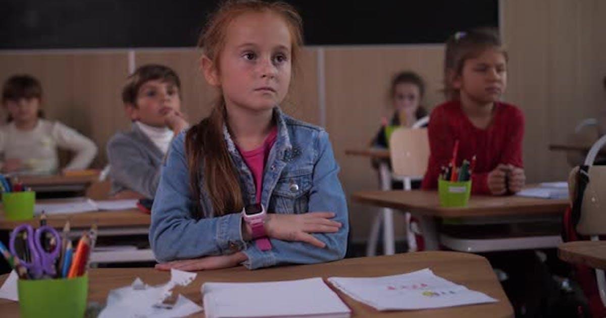 Pupils Attentively Listening To School Teacher
