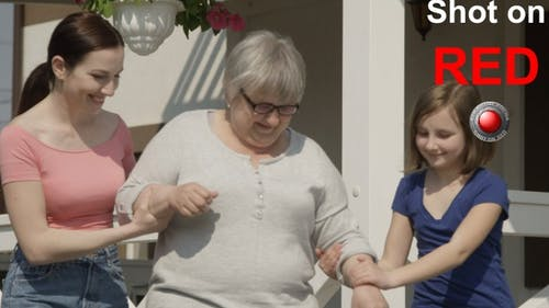 Helping Grandmother To Walk