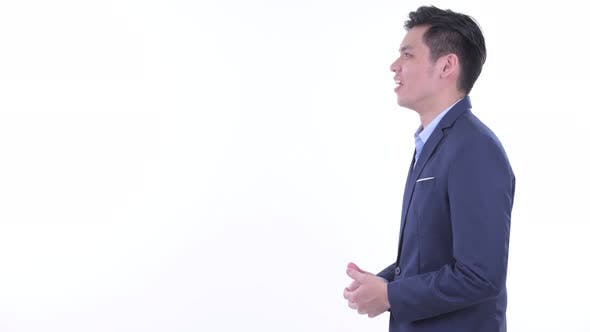 Thumbnail for Profile View of Happy Young Asian Businessman Talking