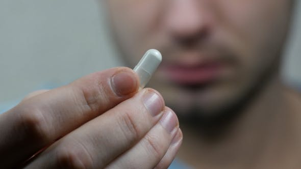 Thumbnail for Extreme  Man Face Taking White Pill, Mouth View Swallowing Pills And Smile