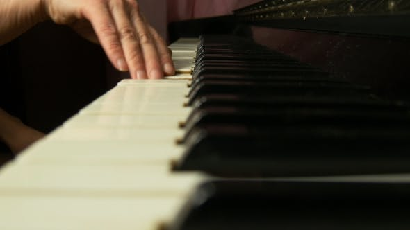 Thumbnail for Female Hands Playing a Gentle Piece Of Classical Music On a Beautiful Grand Piano