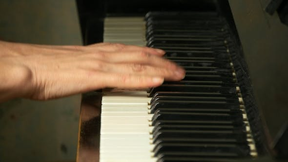 Thumbnail for Female hands is playing on a piano