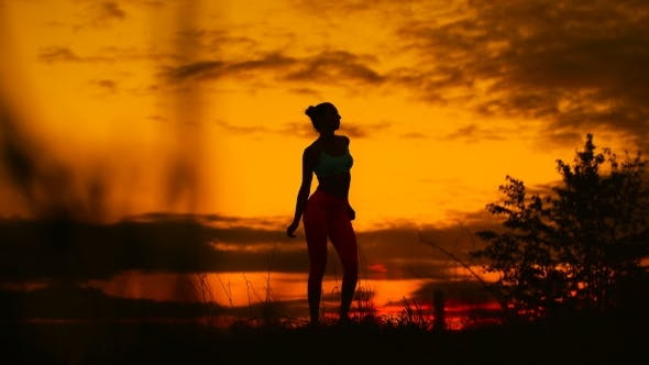 Thumbnail for Carefree Woman Dancing In The Sunset. Vacation Vitality Healthy Living Concept.