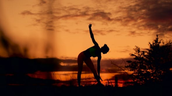 Thumbnail for Slender Young Woman Doing Fitness Exercises In The Warm-up At Sunset. Flexible Shape