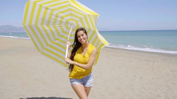Thumbnail for Happy Young Woman Holding a Sun Umbrella