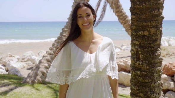 Thumbnail for Gorgeous Woman In White Near Palm Trees