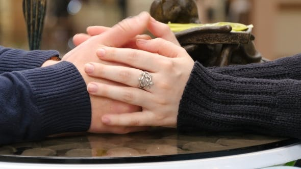 Thumbnail for Happy Couple Holding And Touching Each Others Hands At Cafe In Shopping Mall.