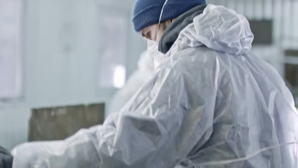 Thumbnail for Worker of Garbage Recycling Facility Sorting Waste