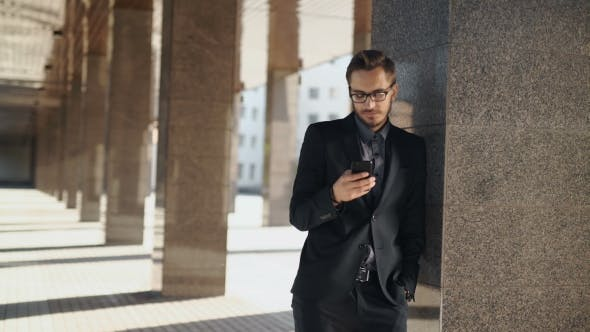 Thumbnail for Casual Urban Professional Businessman Using Smartphone