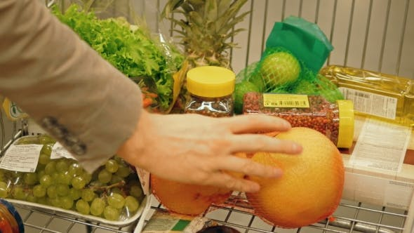 Thumbnail for Male Hand Putting Fruit In A Shopping Trolley, Healthy Food Concept
