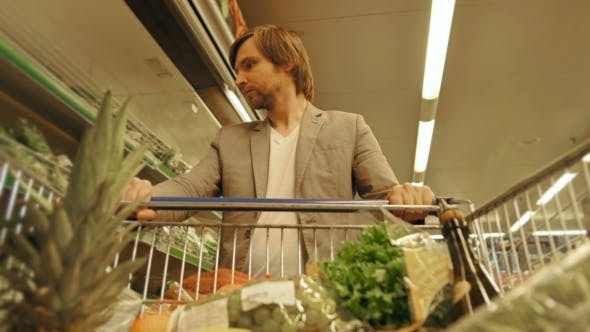 Cover Image for Handsome Man Shopping In A Supermarket, View From Shopping Trolley