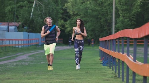 Man And Woman Commit a Jog