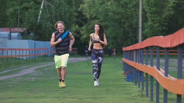 Thumbnail for Man And Woman Commit a Jog