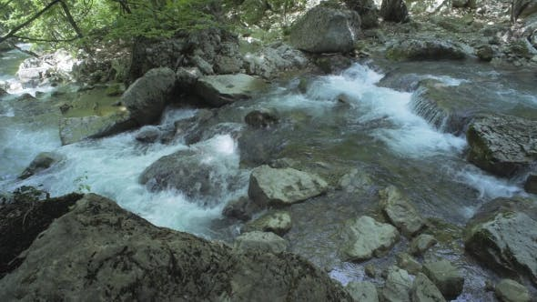 Thumbnail for Stones And Mountain River With Small Waterfall