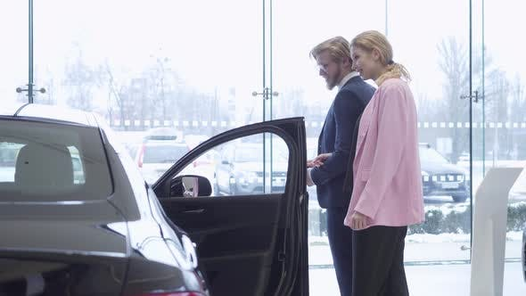 Thumbnail for Happy Couple Chooses a New Vehicle in a Car Dealership