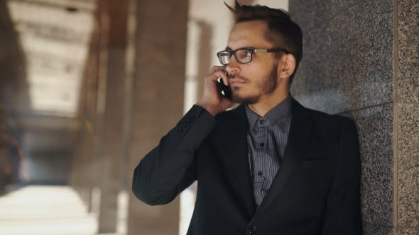 Thumbnail for Portrait Of Young Successful Business Man Having Cell Telephone