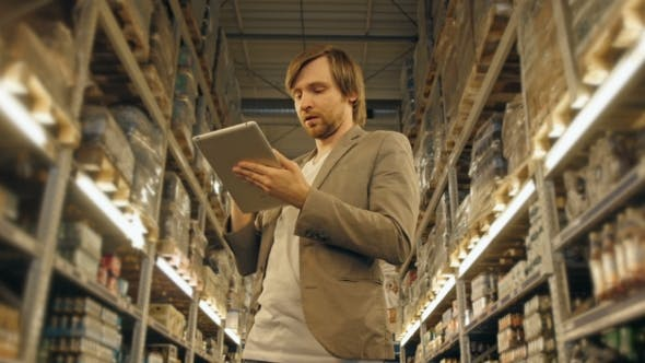 Thumbnail for Manager With Tablet PC Checking Goods At Supermarket Warehouse