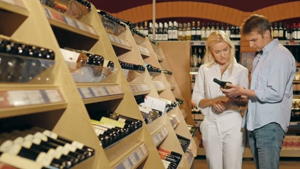 Thumbnail for Beautiful Couple Choose Wine In The Supermarket