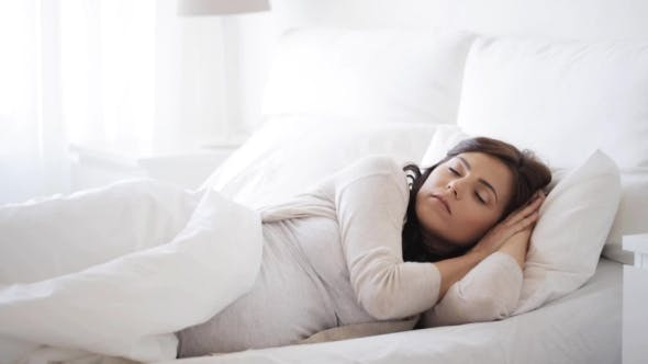 Thumbnail for Pregnant Woman Sleeping In Bed At Home 19