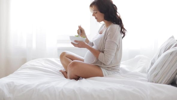 Thumbnail for Pregnant Woman Eating Salad In Bed At Home 23