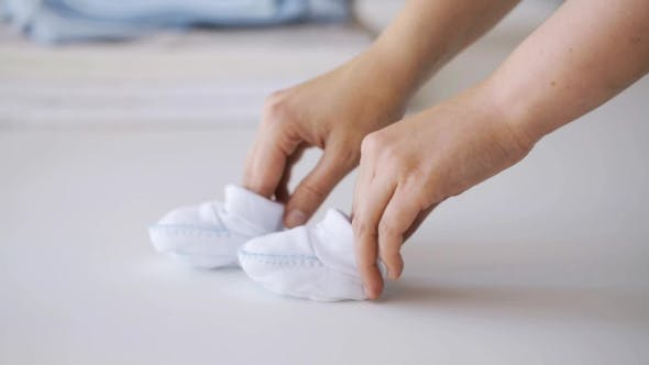 Thumbnail for Woman Hands With Baby Bootees At Home 9