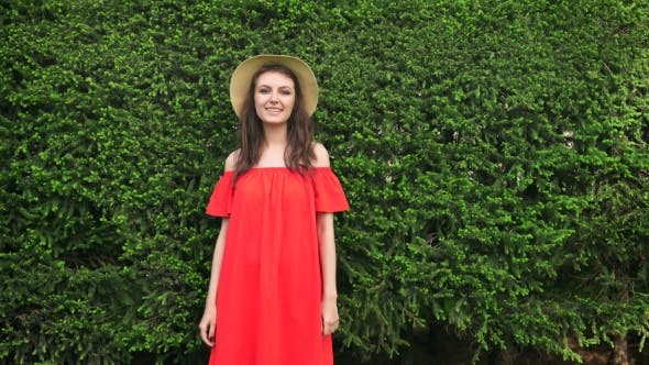 Thumbnail for Beautiful Happy Model Standing Playful In Red Dress On Nature