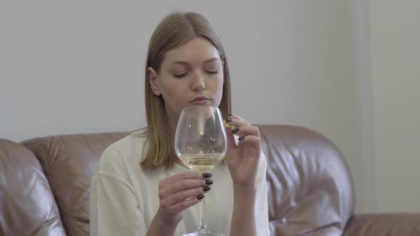 Thumbnail for Sad Woman Holding Wedding Ring Under the Wine Glass
