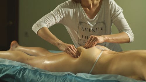 The Woman Doing The Massage Of The Buttocks