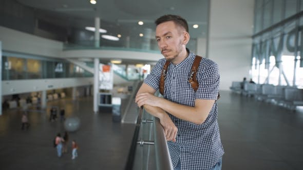 Thumbnail for Stylish Hipster At The Airport Waiting For The Arrival Of The Aircraft.
