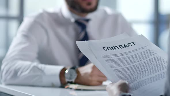 Thumbnail for Business Partners Discussing Contract