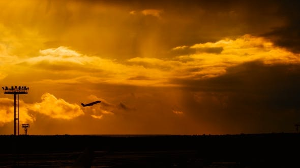 Thumbnail for Passenger Plane Fly Up Over Take-Off Runway From Airport At Sunset
